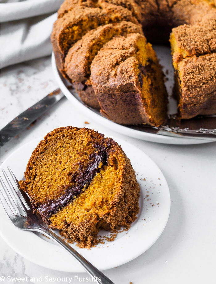This fabulous pumpkin bundt cake combines pumpkin purée, fall spices and chocolate to make a Pumpkin Chocolate Swirl Bundt Cake worthy of special occasions.