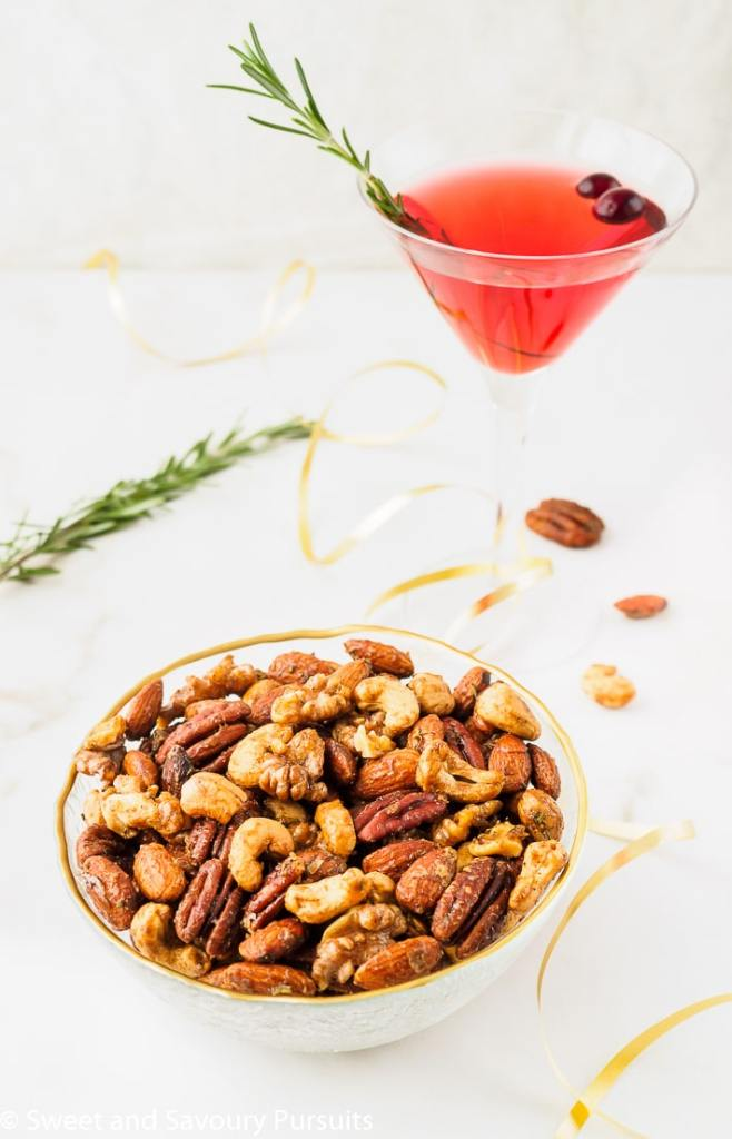Bowl of Mixed Nuts served with a cocktail.