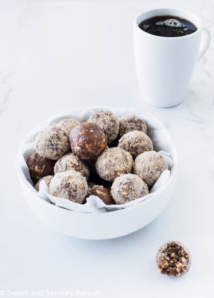 Bowl of No-Bake Maple Espresso Bites served with a cup of coffee.