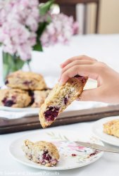 A close-up of an American style Blackberry Scones spiced with vanilla and just a hint of cinnamon.