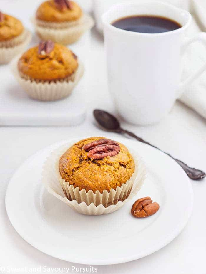 A Sweet Potato Muffin served on a small white dish.