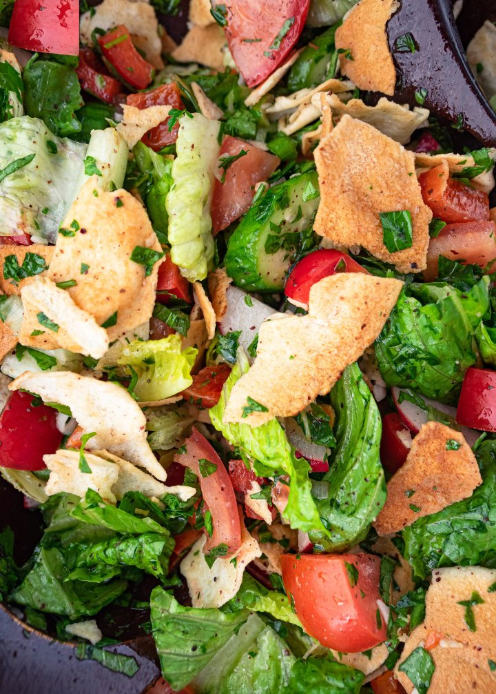 Close-up of a dressed and tossed fattoush salad.