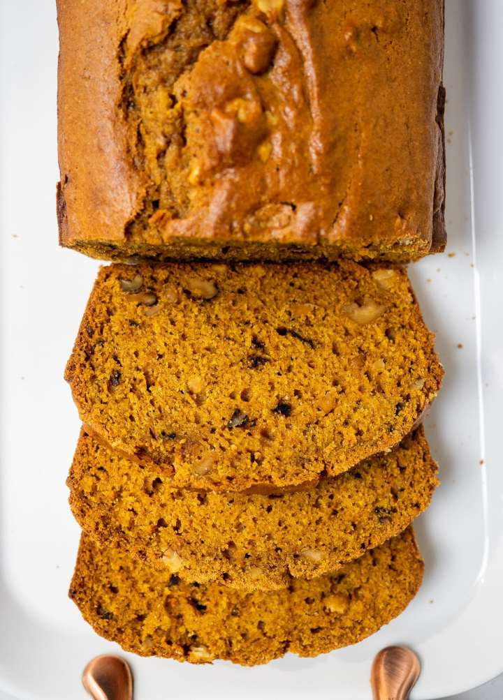 Top view of a partially sliced pumpkin bread.