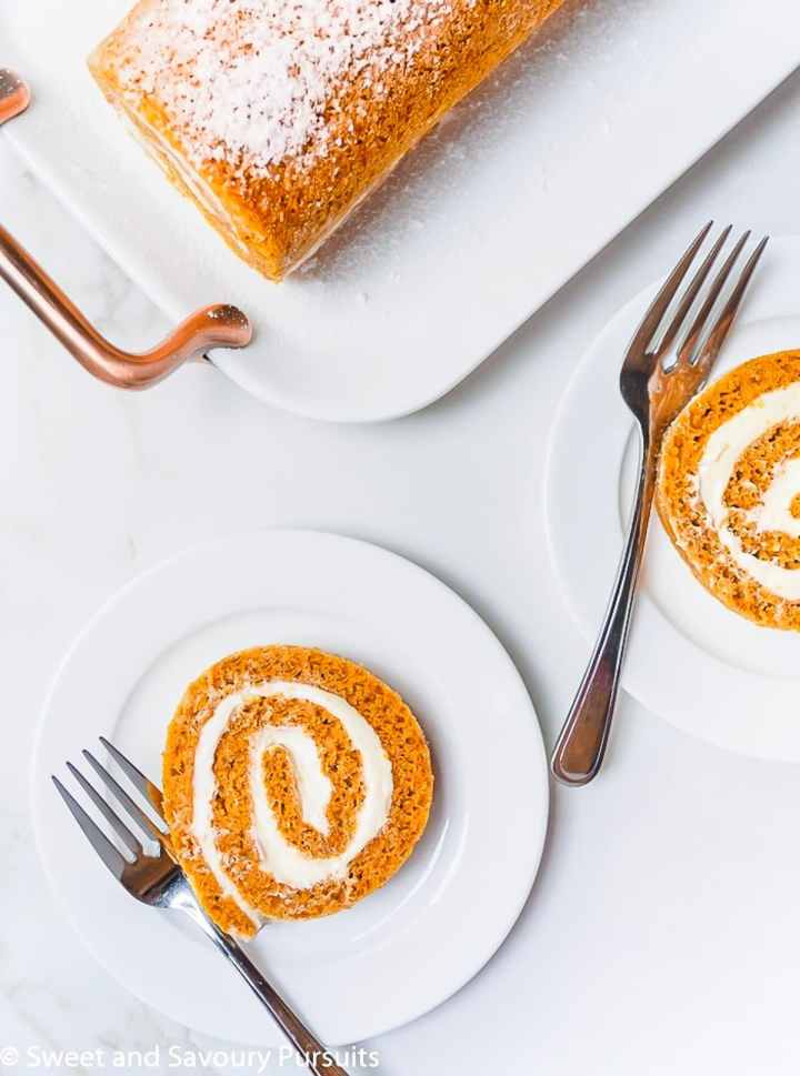 Plated slices of a pumpkin roll cake.
