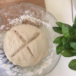 Preparing focaccia dough for potatoes and rosemary focaccia