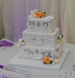 3 Tier white suitcase wedding with flowers
