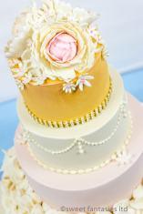 4 Tier wedding cake with petals & flowers