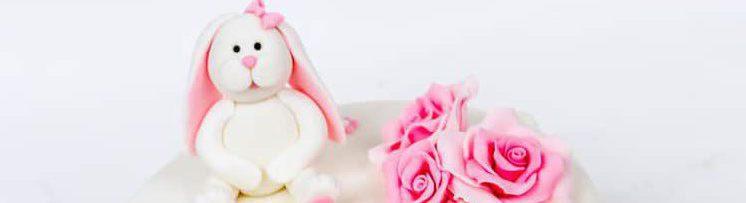 Girls Christening Cake with sugar paste rabbit