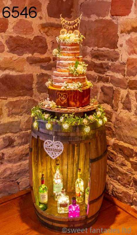 4 Tier Round Wedding Cake (3 Tiers Naked, 1 Tier Iced)