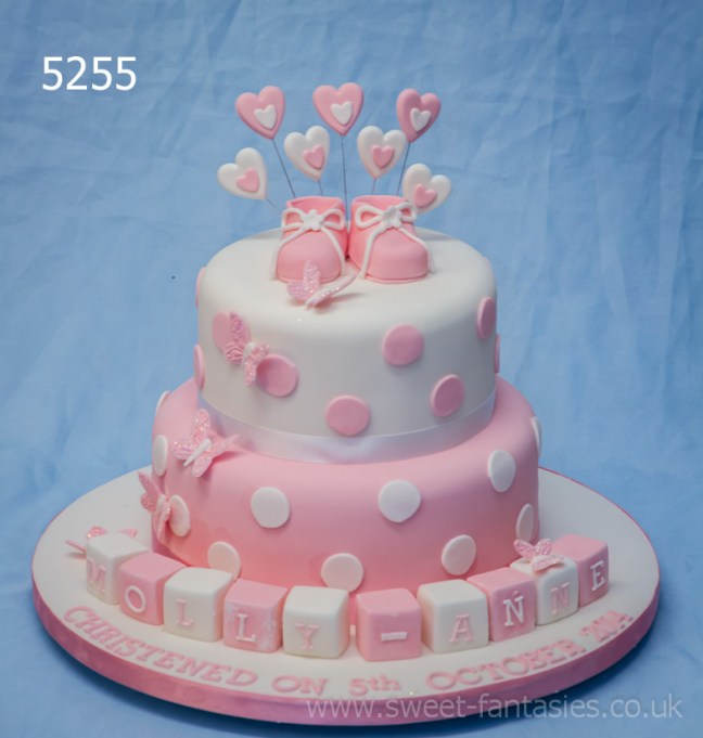 pink & white 2 tier girls christening cake with booties