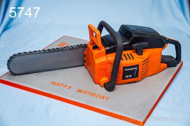 3D chain saw birthday cake