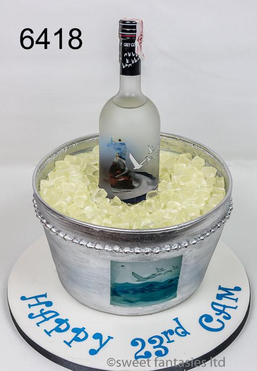 Grey Goose Vodka bottle in ice bucket birthday cake