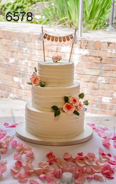 Buttercream wedding cake with flower sprays