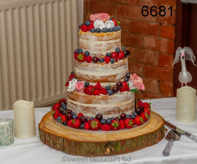 3 tier semi-naked cake with roses & fresh fruit