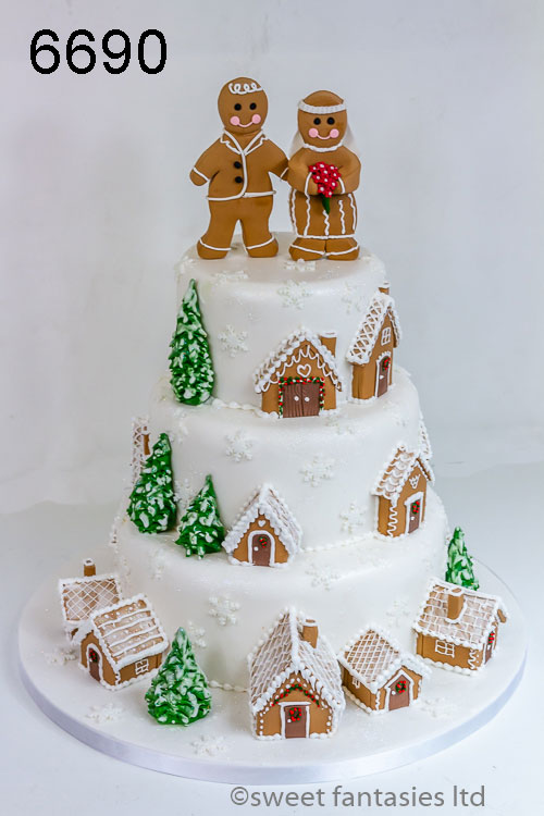 Christmas wedding cake with gingerbread houses & gingerbread Bride & groom
