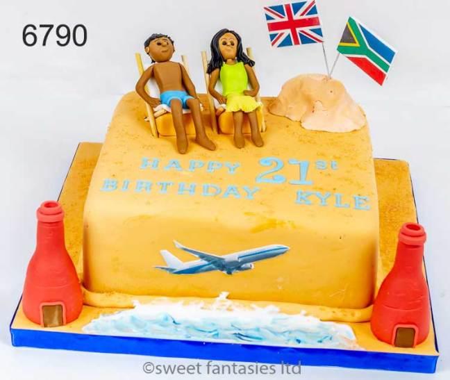 Boy sunbathing on beach, travel theme 21st birthday cake