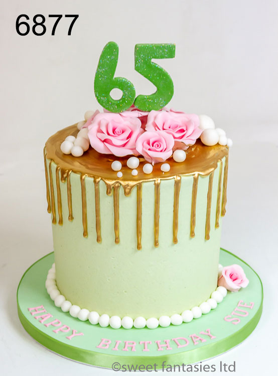 65th birthday. Gold drip cake with pink roses