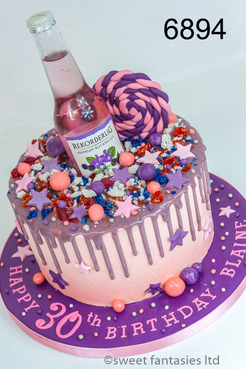 Purple & silver drip cake with a bottle