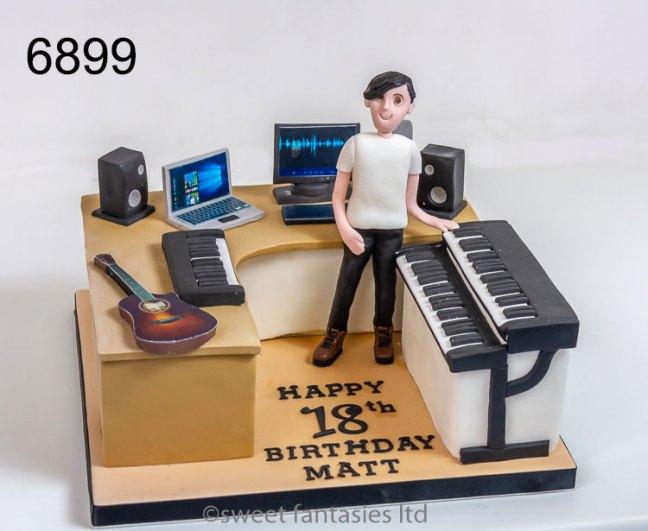 Boy playing keyboard plus guitar & computer, 18th cake,