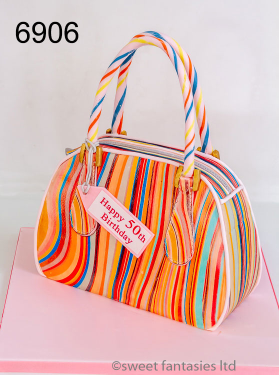 Ladies 50th cake, 3D stripy multi coloured handbag
