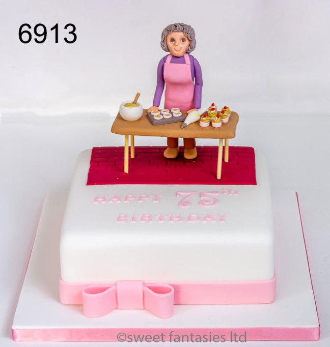 75th birthday cake with a model of a lady baking