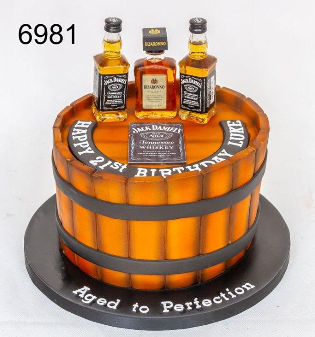3D barrel with jack daniels bottles. boys 21st cake