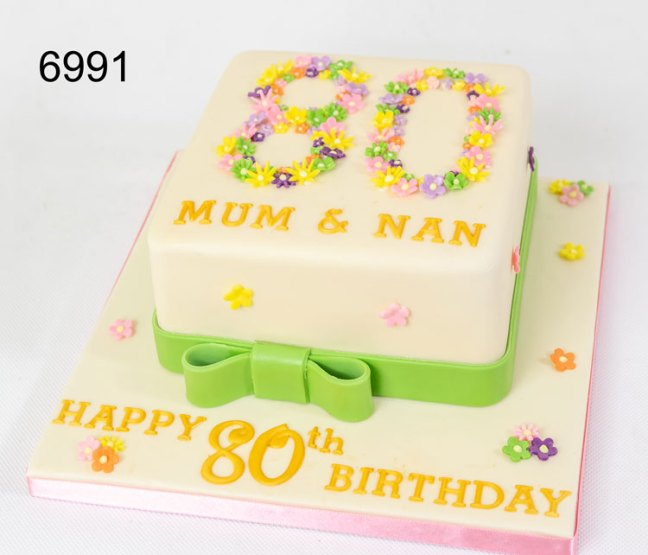 80th birthday cake with multi coloured flowers