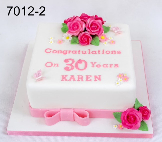 White & pink ladies cake with deep pink roses