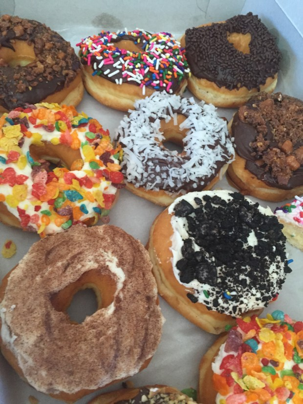 DIY Donuts with toppings: cinnamon & sugar, cookie crumbs, sprinkles, candy, cereal & coconut
