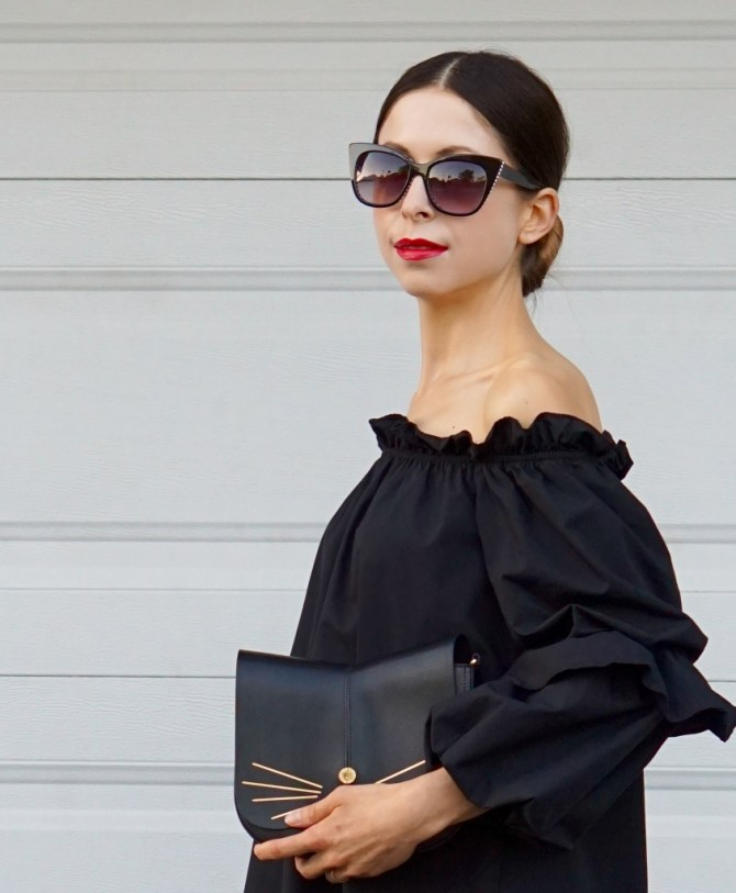 The black off-shoulder Ruffle Dress is comfortable, trendy and classic at the same time! The cute kitty-shaped purse and lace-up shoes complete the look.