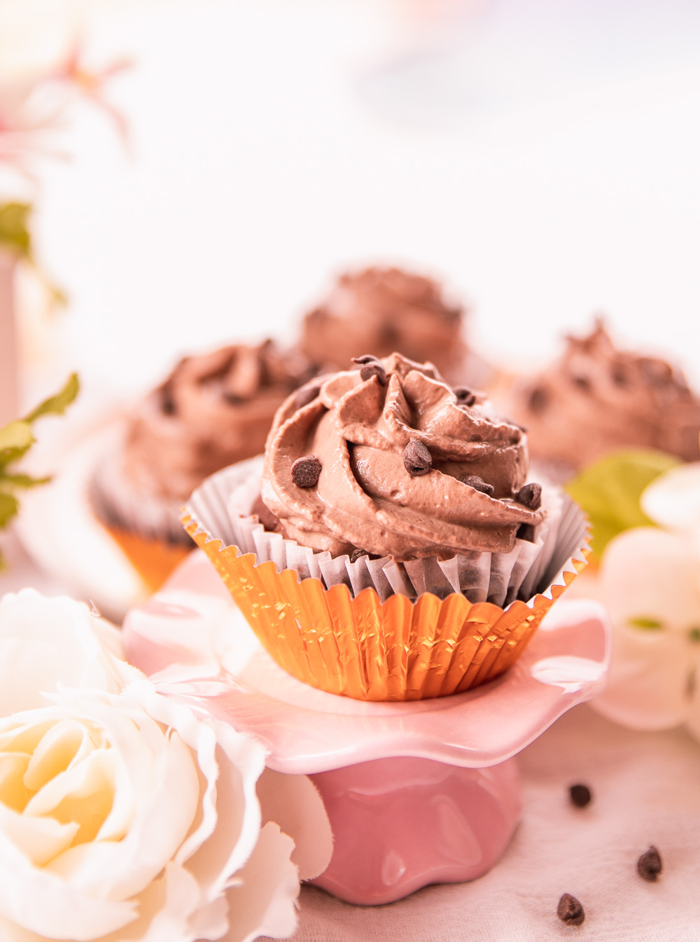 A recipe for the Healthy Chocolate Chip Cupcakes topped with yogurt-based frosting that are low-calorie, all-natural, easy to make, yummy and delicious! #healthydessert #healthysnack #lowcaloriedessert #lowcaloriesnack #lowcalorie #lowcalorierecipe #healthy #healthyrecipe #healthydessertrecipe #lowcaloriemeal #wholegrain #easyrecipe #healthycake #lowcaloriecake #lowcaloriefrosting #healthycupcake #lowcaloriecupcake #healthycupcakes #lowcaloriecupcakes #lowcaloriefrosting