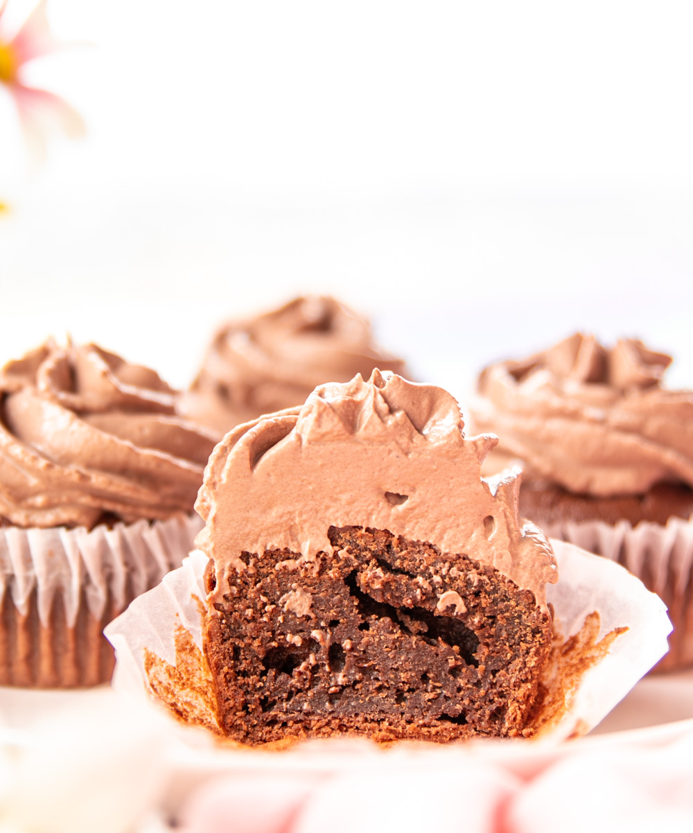 A Recipe for The Easiest Healthy Chocolate Cupcakes that are topped with yogurt-based frosting and are low-calorie, all-natural, easy to make, yummy and delicious!