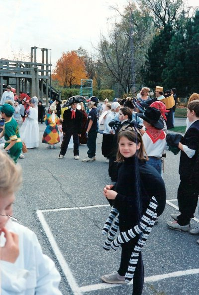 Umm.. the nineties sometime? Maybe 1990? Making me seven...ish? A SPIDER! Check our all of those homemade costumes. Nary a franchise or licensed character to be seen.