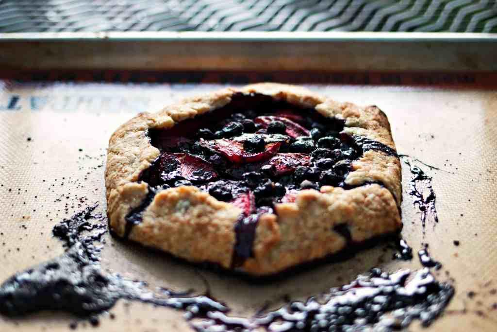 a celebratory blueberry & plum pie   gluten free plant based recipes via sweet miscellany