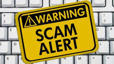 Is It A Scam Learn How To Spot a Scam - Scam Alert On Keyboard Background