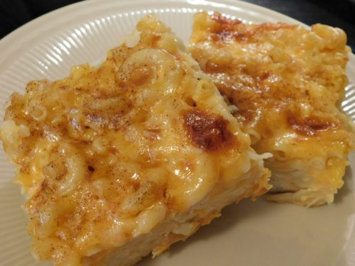 The addition of eggs, evaporated milk, eggs, butter, and mustard powder in its recipe gives this custard-style baked Macaroni and Cheese dish lots of cheesy gooey goodness.