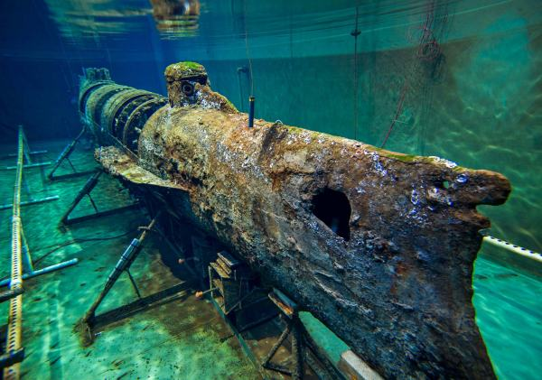 Made out of 40 feet of bulletproof iron, the H.L. Hunley was the world's first successful combat submarine. However, shortly after sinking the USS Housatonic on February 17th, 1864, the Hunley vanished without a trace. The disappearance, one of the greatest mysteries in maritime history, baffled treasure hunters and history buffs as they searched in vain for the submarine. Then, the sunken civil war-era submarine Hunley was discovered about four miles off the coast of Sullivan's Island in 1995. All eight crew members were eerily in position at their stations when the sub was discovered on the ocean floor. However, it wouldn't be until August 8th, 2000 that she was gently lifted from her ocean grave and delivered to the Warren Lasch Conservation Center for study, excavation, and preservation. The actual Hunley is preserved and on display in a tank of water!