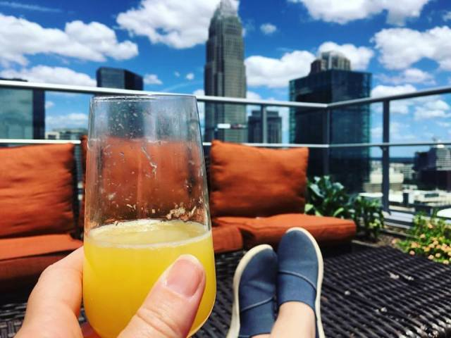 Kicking back and enjoying the city view with a mimosa.