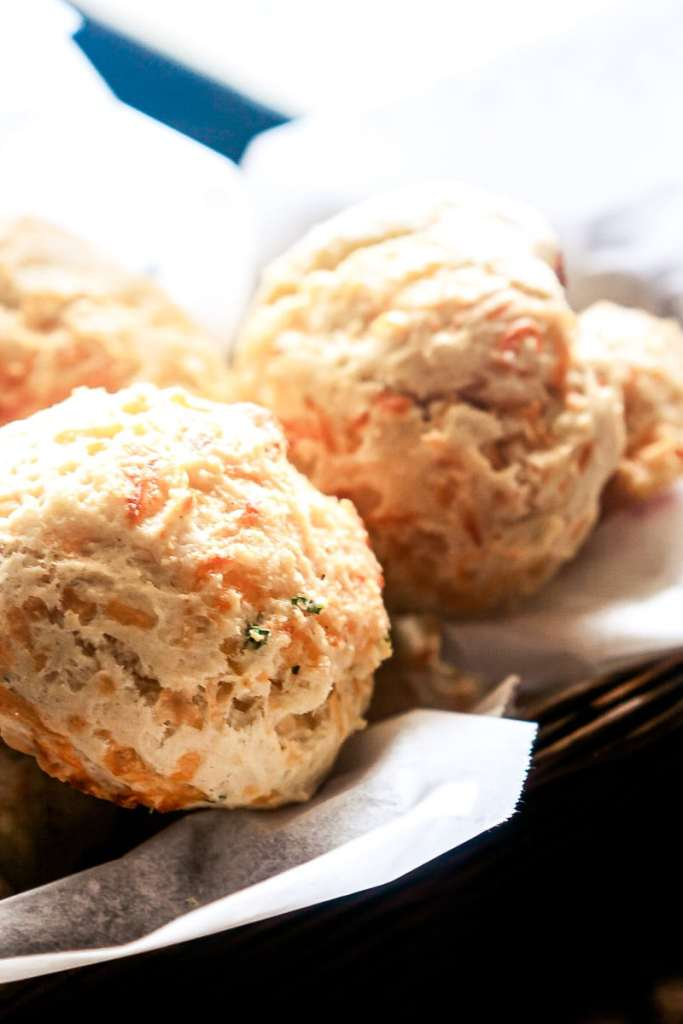 a small wicker basket full of baked red lobster cheddar bay biscuits