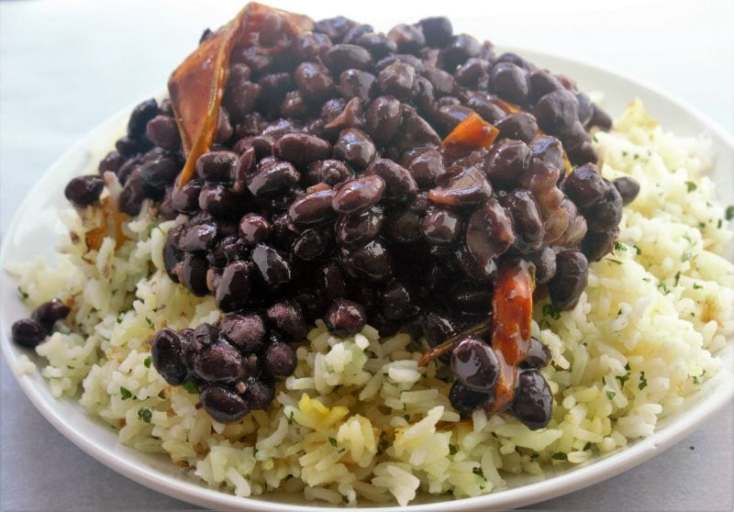 Cuban black beans are a quintessential South Florida side dish that is so simple to make and takes your house down to South Florida with onions, bell peppers, and spices.