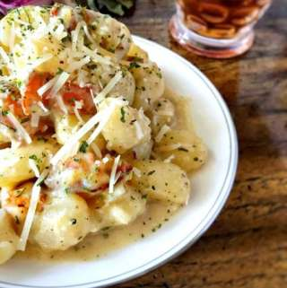 Amazingly tender gnocchi are bathed in two of the best things in the world: bacon and cream, then sprinkled with cheese for one of the best dishes ever.