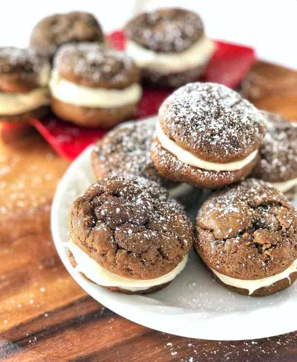 Super soft, sweet and spicy, cake-like gingerbread whoopie pies, made with fresh ginger, sandwich a sweet marshmallow and cream cheese filling. Fantastic for Christmas baking!