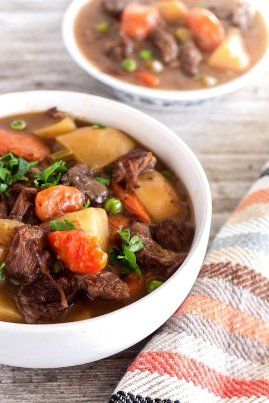 Rich and comforting beef stew made in about an hour in the Instant Pot! This recipe is easy, fast, and full of flavor with garlic, herbs, and loads of veg.