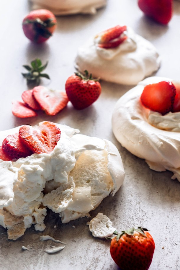 Mini pavlovas filled with chantilly cream and topped with strawberries are the perfect way to celebrate any occasion, including the welcoming of spring and summer!