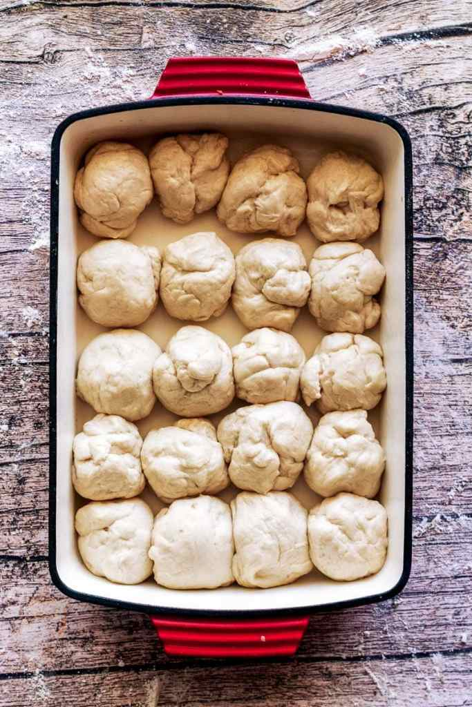 overhead shot of homemade dinner rolls unrisen in pan