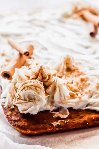 close up of cream cheese frosting on pumpkin cake