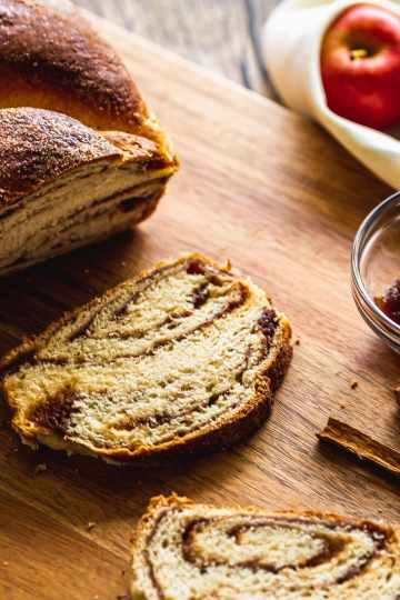 close up of a slice of apple babka on wooden tray