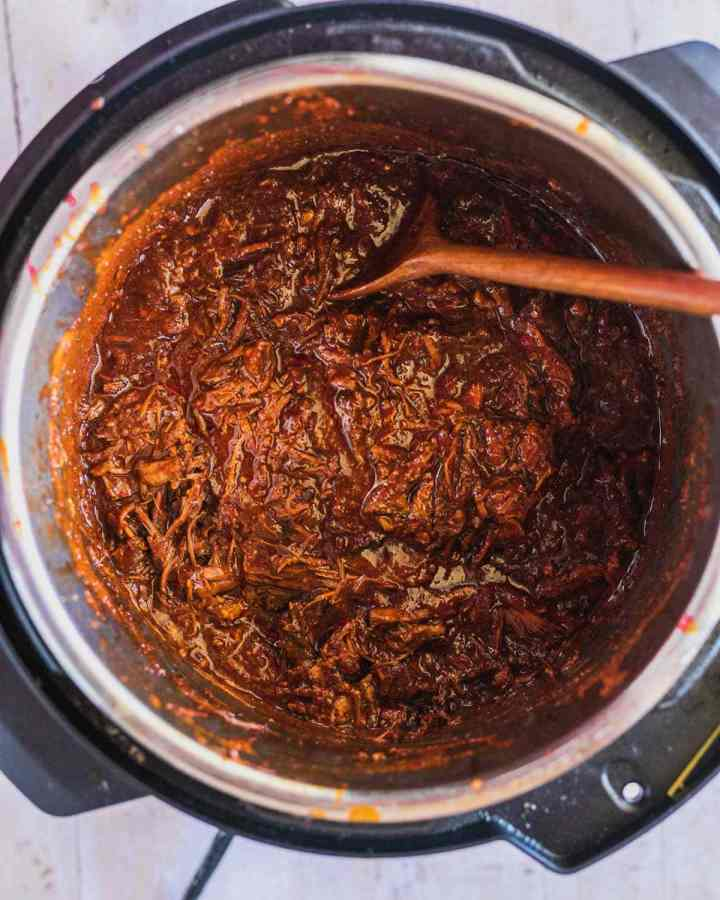 overhead view of shredded beef birria in the instant pot pressure cooker