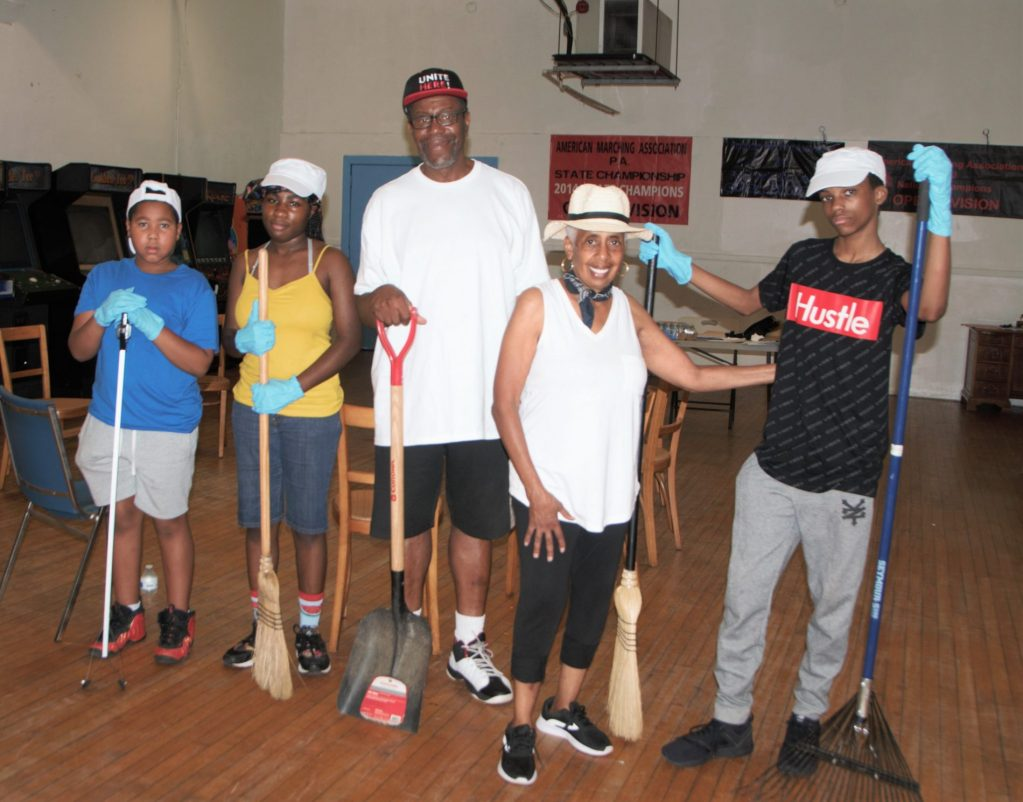 Rakes, brooms, and shovels in hand, Southwest youth prepare to clean up the sidewalk areas around Myers Rec. Center on a blisteringly hot Saturday, July 20.   Pictured are Tysir, Robert, and Jahmirah along with parent Jeff and Dr. Carol Simmons, Chief of Staff for TIIAI/Gateway for ReEntry