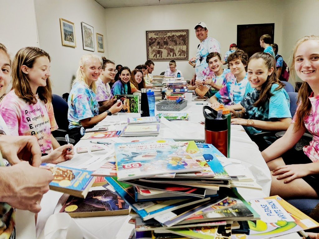 Youth from several United Church of Christ congregations in Tonawanda NY sort children's books at WePAC in West Philly.  Their volunteering at other sites was coordinated by their Southwest hosts The Common Place.